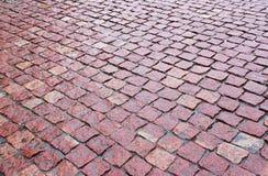 Cobblestones of red granite Stock Images