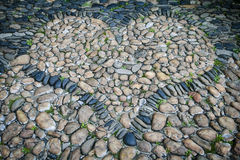 Cobblestones in shape of heart Stock Photography