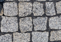 Cobblestones of a street in detail. Royalty Free Stock Images