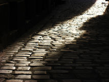 Cobblestones and sunset. Old cobblestone pathway in Wroclaw city royalty free stock image