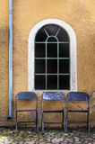Cobblestones and three chairs Royalty Free Stock Photos