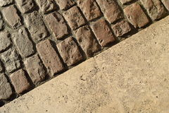 Cobblestones and tiles Royalty Free Stock Photography