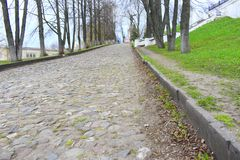 Cobblestones are typically either set in sand or similar material, or are bound together with mortar. Paving with cobblestones allows a road to be heavily used royalty free stock photo