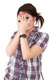 Coberta adolescente da menina seu olho imagem de stock