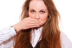 Coberta bonita da mulher sua boca Foto de Stock Royalty Free