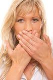 Coberta da mulher sua boca com mãos Imagem de Stock Royalty Free
