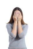 Coberta da mulher sua face com ambas as mãos foto de stock