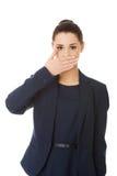 Coberta nova da mulher de negócios com mão sua boca Fotos de Stock