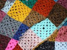 Cobertor colorido feito das lãs Fotografia de Stock