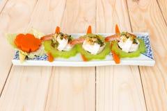 Cobertura fervida do camarão, do calamar e do vegetal com molho de marisco picante Fotografia de Stock Royalty Free