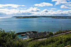 Cobh harbour in County Cork. Beautiful summers day looking across the blue water of Cobh harbour with fluffy blue clouds in the sky Stock Photography