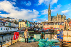 COBH, IRELAND - NOVEMBER 26 : harbour and town on November 26, 2012 in Cobh Ireland. COBH, IRELAND - NOVEMBER 26 : harbour and town with St. Coleman's neo-Gothic Stock Image