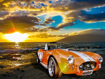 Shelby Cobra. A vintage luxury sport Shelby Cobra 427 on the beach at sunset. Kamaole Beach, Maui, Hawaii Royalty Free Stock Photography