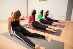 Cobra pose in yoga class Stock Photos
