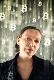 CoBusinesswoman collecting bitcoins Royalty Free Stock Photos