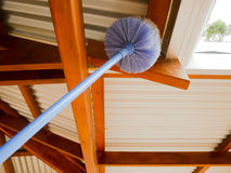 Cobweb brush sweeping spiderweb Stock Photography