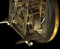 Cobwebs and dust on the old clock mechanism. Isolated Royalty Free Stock Images