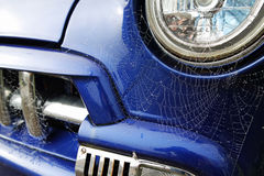 Cobwebs on an old blue truck. Cobwebs on the front of an old blue truck, taken in the UK Stock Images