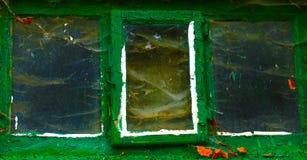 Cobwebs on old green window Stock Photo