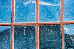 Cobwebs on an old Windows. The big Cobwebs on an old Windows Royalty Free Stock Photo