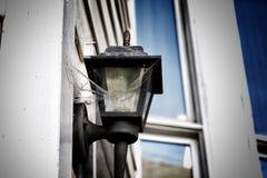 Cobwebs. Outside outdoors light lamp cobwebs old Royalty Free Stock Images