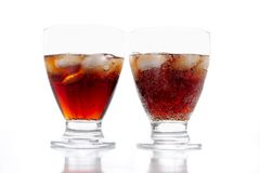 Coca-cola. Close-up of two glasses of coca-cola on a white background Royalty Free Stock Images