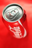 Coca Cola. Detail of fresh Coca Cola can on red background royalty free stock photo