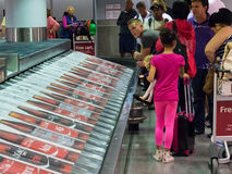 Coca Cola advertisement in luggage conveyor belt Royalty Free Stock Image