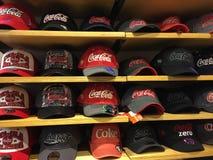 Coca-Cola baseball hats inside Coca-Cola gift shop. Royalty Free Stock Photos