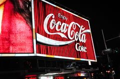 The Coca-Cola billboard at the top of William Street, Kings Cross, Sydney at night.