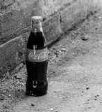 Coca Cola. Bottle found in an alley royalty free stock photos