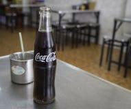 Coca Cola bottle on lunch table. Thai Coca Cola glass bottle on lunch table royalty free stock photo