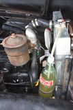 Coca Cola bottle used for storing car radiator overflow fluid. WEST FARGO, June 20, 2018: The Coca Cola bottle serving as a radiator holding tank on a hot rod is royalty free stock images
