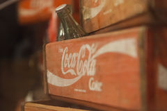 Coca cola bottles in wooden crate. Royalty Free Stock Images