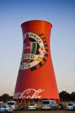 Coca-Cola Branded Smoke Stack. Large edge to edge graphics cover this landmark structure, found adjacent to the Soccer City Stadium Stock Photos