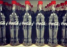 Coca - cola buteljerar linen up Royaltyfri Bild