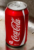 Coca cola can. Major beverage maker Coca Cola - can on metal background