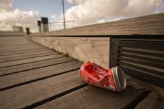 Coca-Cola can on boardwalk Royalty Free Stock Photo
