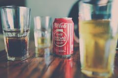 Coca Cola Can Beside Clear Drinking Glass With Black Liquid Royalty Free Stock Images