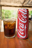 Coca-Cola can drink and a glass of coke with ice cubes Stock Photography