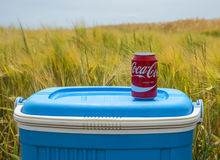 Coca Cola Can in the Field - Tour de France 2015. Quievy,France - July 7,2015: A Coca Cola can is on a fridge box in a field near a cobblestone road during the Royalty Free Stock Photography