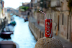 Coca Cola can with straw over canal in Venice Royalty Free Stock Images