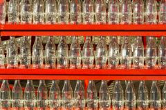 Decoration made of empty Coca Cola bottles. Coca-Cola, or Coke, is a carbonated soft drink produced by The Coca-Cola Company. Originally intended as a patent Royalty Free Stock Image
