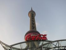 Coca Cola Coke Logo and Oriental Pearl Tower Royalty Free Stock Photography