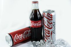 Coca-Cola Company is the largest soft drink. Bangkok, Thailand - NOVEMBER 20, 2017: Bottle and cans of Coca-Cola, Coca-Cola Light and Coca-Cola Zero Sugar on Stock Photo