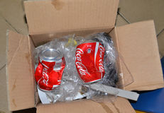 COCA COLA COUNTERFEIT. Two cans of cola coca taste, crumpled and thrown in the trash. They represent a danger because they are counterfeit and have not provided Stock Photos