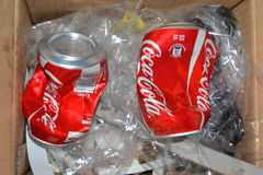 COCA COLA COUNTERFEIT. Two cans of cola coca taste, crumpled and thrown in the trash. They represent a danger because they are counterfeit and have not provided Royalty Free Stock Images