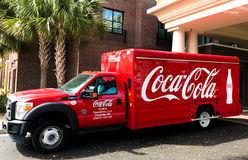 Coca-Cola delivery truck. A Coca-Cola delivery trucks makes another delivery Stock Photos