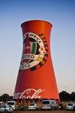 Coca Cola eingebrannter Rauch-Stapel Stockfotos