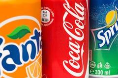 Coca-Cola, Fanta en Sprite-Blikken Stock Afbeelding